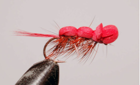 Бороздящая мушка красная